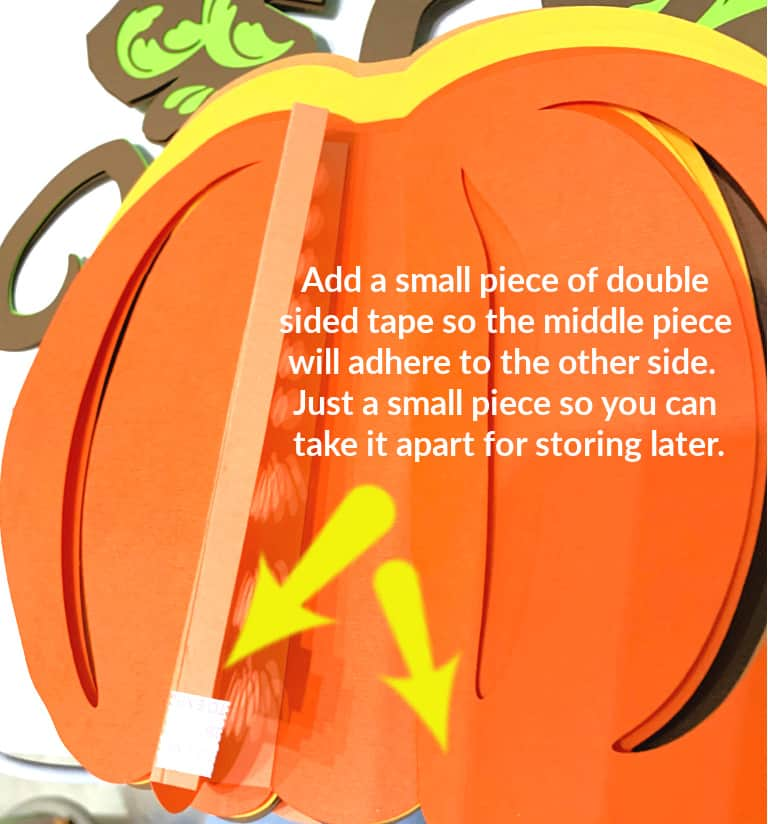Attach a small piece of double sided tape